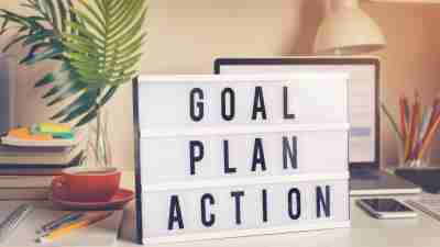 Personal goals: Goal,plan,action text on light box on desk table in home office.