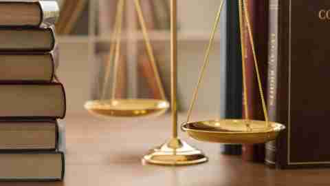 scales of justice with law books in library of law firm. concept of justice, legal, jurisprudence. legislation study.