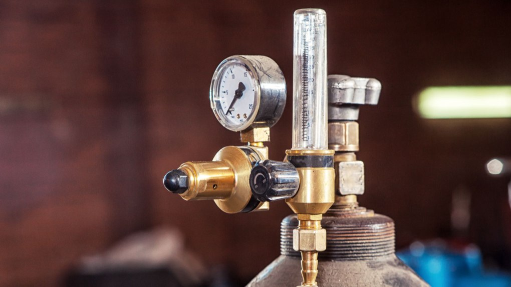 A standard gas regulator fitted to a gas canister.