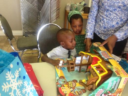 Damilola opens gifts