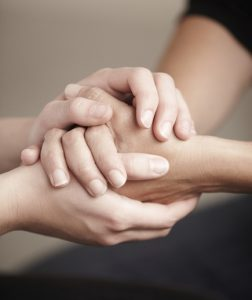 an image of couple's hand holding together