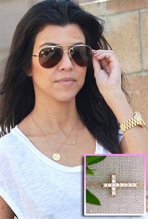 Kourtney Kardashian wears her Sideways Diamond Cross Necklace Layered with Other Dainty Charms