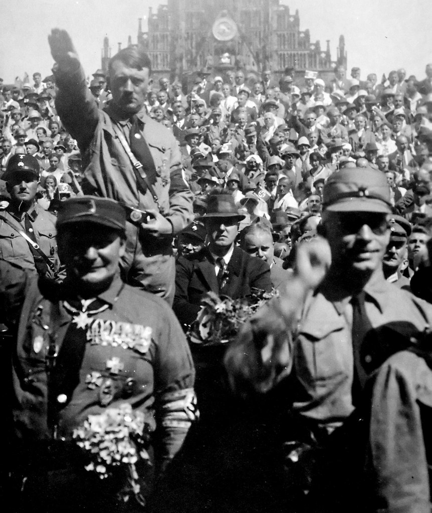 "Hitler and Hermann Göring saluting at a 1928 Nazi Party rally in Nuremberg. This is current progressive view of present day Republicans and ""Conservatives""."
