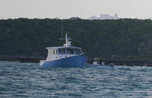 The salvage boat successfully pulls him off and tows him to Staniel Cay