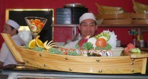 Our sushi chef with one of his works of art