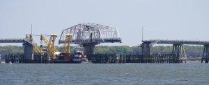Barge squeezing through Lady Island Swing Bridge