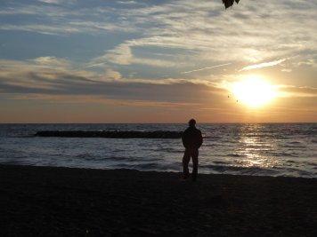 Steve walking along the beach