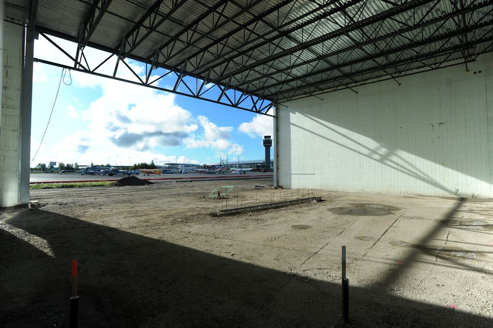 One of six units in the first hangar building currently under construction faces the terminal at Ted Stevens Anchorage International Airport on Tuesday. (Erik Hill / Alaska Dispatch News)