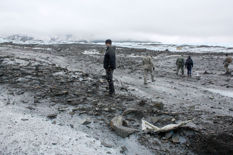 Allen Cronin stands amid debris on Colony Glacieron Wednesday. (Laurel Andrews / Alaska Dispatch News)