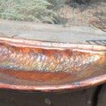 Copper birdbath with dragonfly