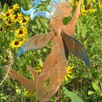 Steel fairy on garden stake