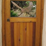 roadrunner gate, steel, cedar, adobe dragon design