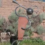 Kokopelli sculpture in stone and steel