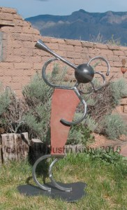 Kokopelli sculpture in stone and steel