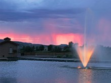 Adobe Falls fountain lit up at sunset