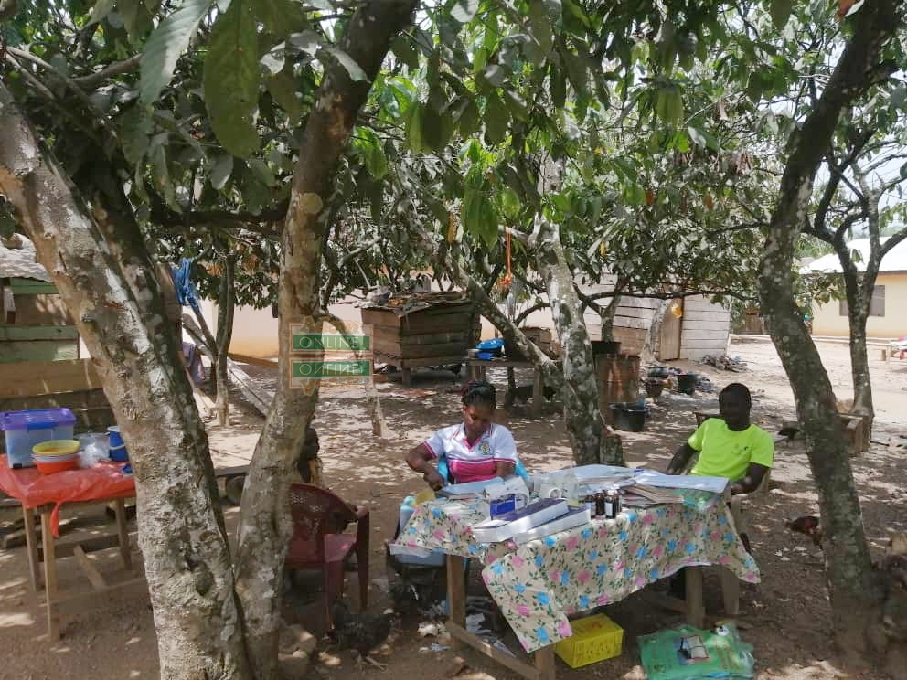 Nursing mothers at Amonom, a farming community in the Atiwa West district of the Eastern region, are appealing for Community-based Health Planning and Service (CHPS) compound as their children (babies) are weighed and treated under cocoa trees.