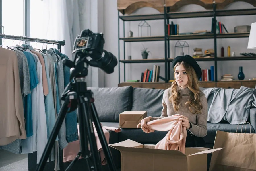 Woman recording a fashion haul video for her YouTube channel
