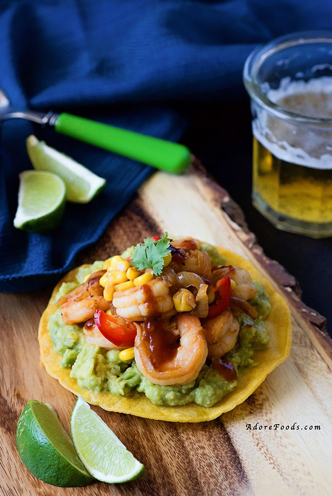 Spicy Chipotle Shrimp & Corn Tostadas - crunchy corn tortillas, creamy adobo guacamole and juicy shrimp and corn topping. One of the best tostadas I have ever had #mexican #cincodemayo
