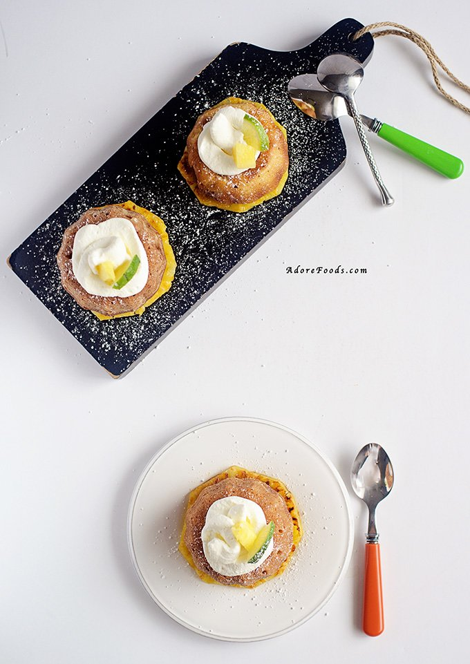 Moist pineapple and lime mini bundt cakes, served on rum and brown sugar grilled pineapple slices topped with whipped coconut cream