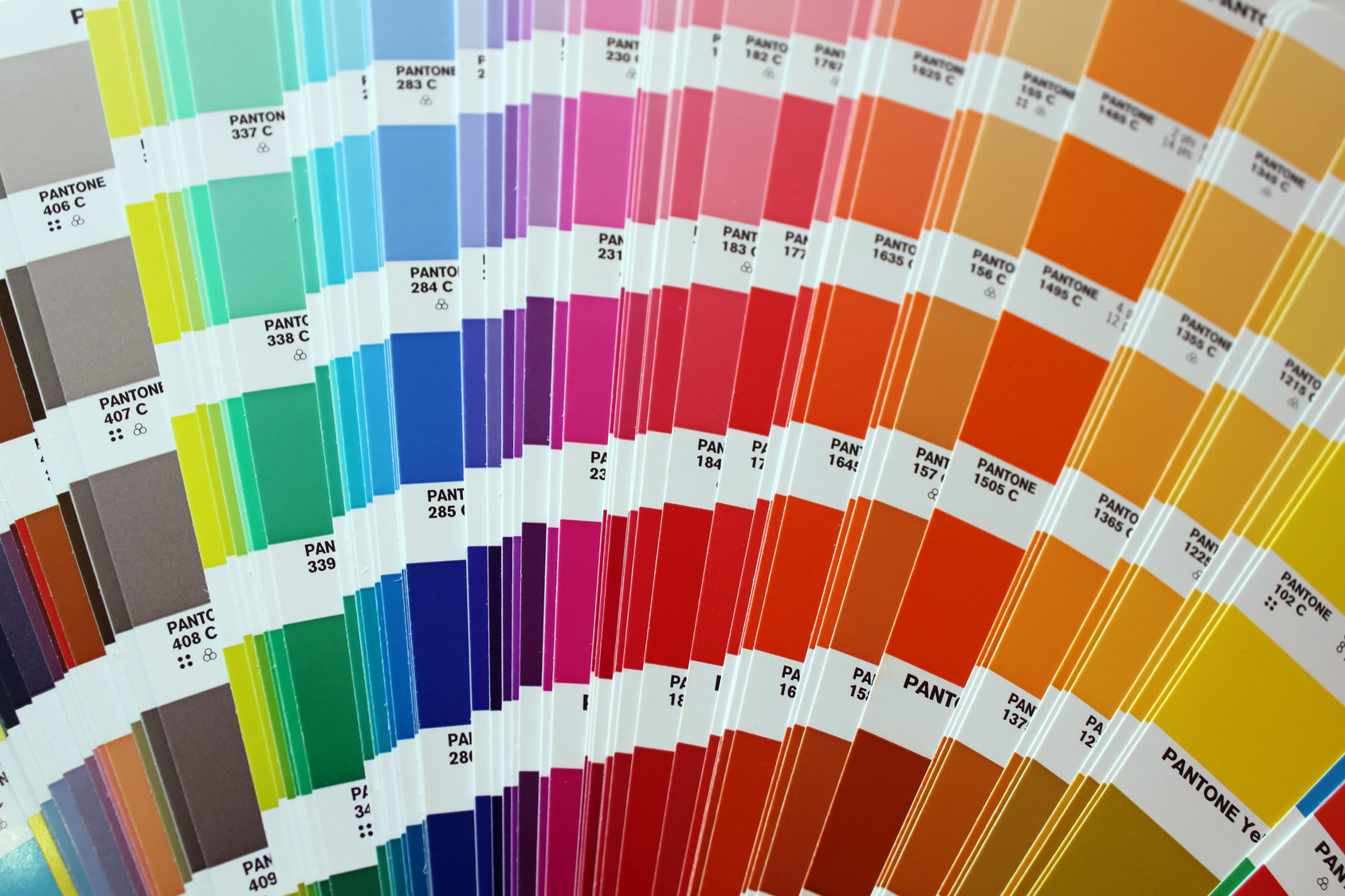 Pantone book showing a range of spot colours swatches and their CMYK codes
