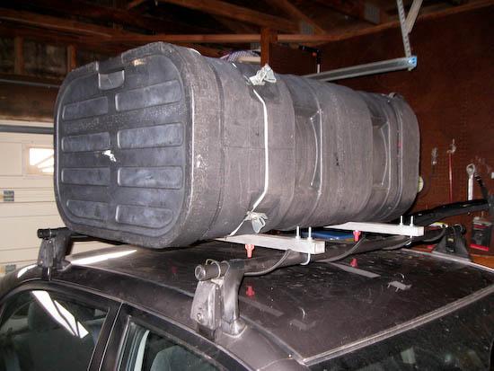 Cargo box mounted on yakima roof rack (notice the white weatherstrip installed)