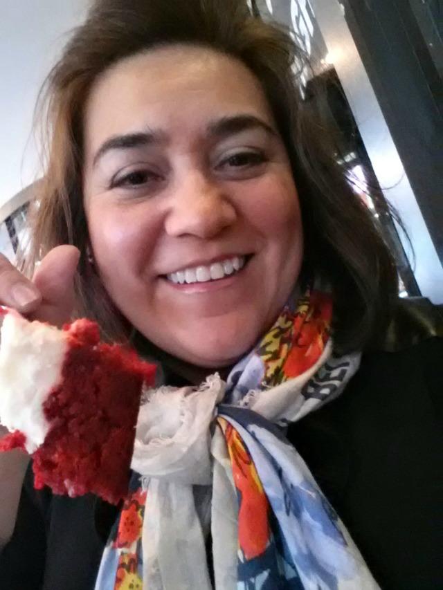 Adriana Martin enjoying Juniors Red Velvet Cheesecake