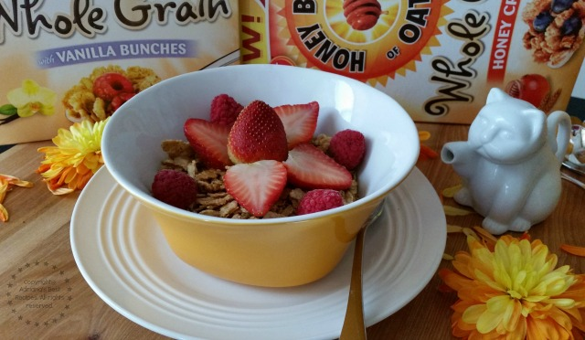 Celebrating with Cereal Honey Bunches of Oats Whole Grain with strawberries and almond milk