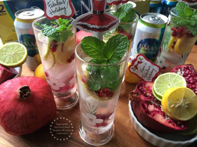 The holidays call for fabulous drinks that are family friendly like this Minty Lemon Lime Pomegranate Spritzer made with fresh seasonal fruit, citrus and DASANI Sparkling Water #SparklingHolidays #ad
