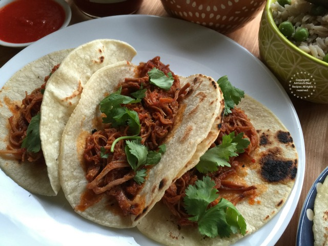 Shredded pork on red chile sauce is perfect for eating with rice and refried beans