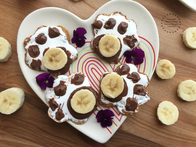 Yummy sweet paw prints with chocolate hazelnut spread, marshmallow and banana slices