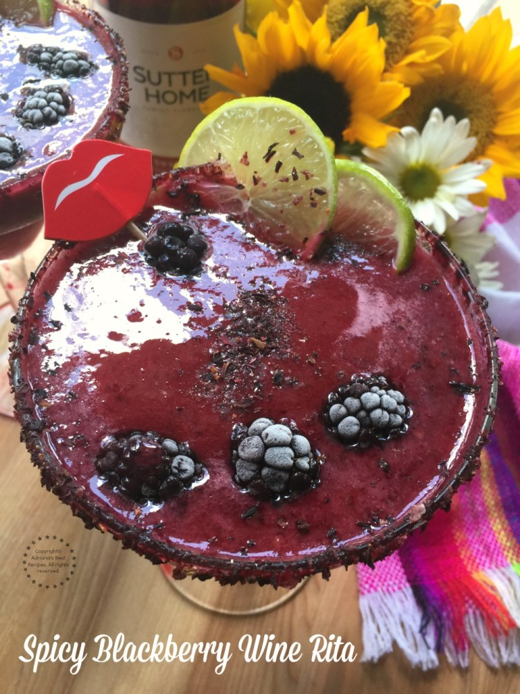 Cheers with this Spicy Blackberry Wine Rita made with frozen store bought margarita mix, blackberries, green habanero sauce, tequila blanco, hibiscus salt and Sutter Home Sweet Red Wine