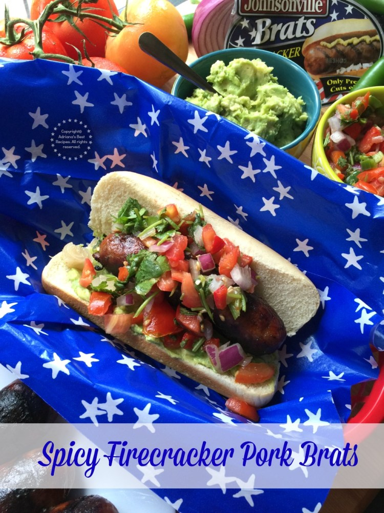 Spicy Firecracker Pork Brats garnished with avocado mash and pico de gallo salsa