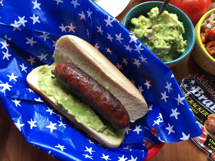 Spread some of the avocado in the butter bun and add the grilled brat