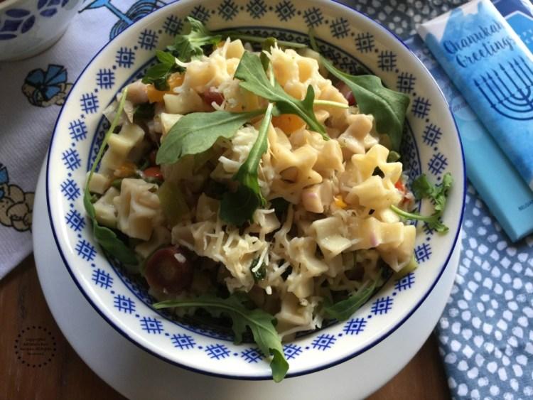 Garnish the pasta with fresh arugula leafs