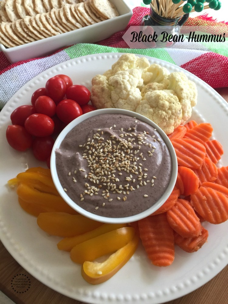 Black bean hummus made with canned beans, tahini, olive oil, lemon juice, garlic and cumin