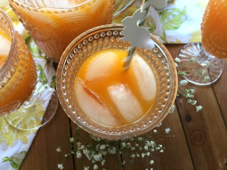 Sipping carrot clementine pineapple punch with cute bunny straws