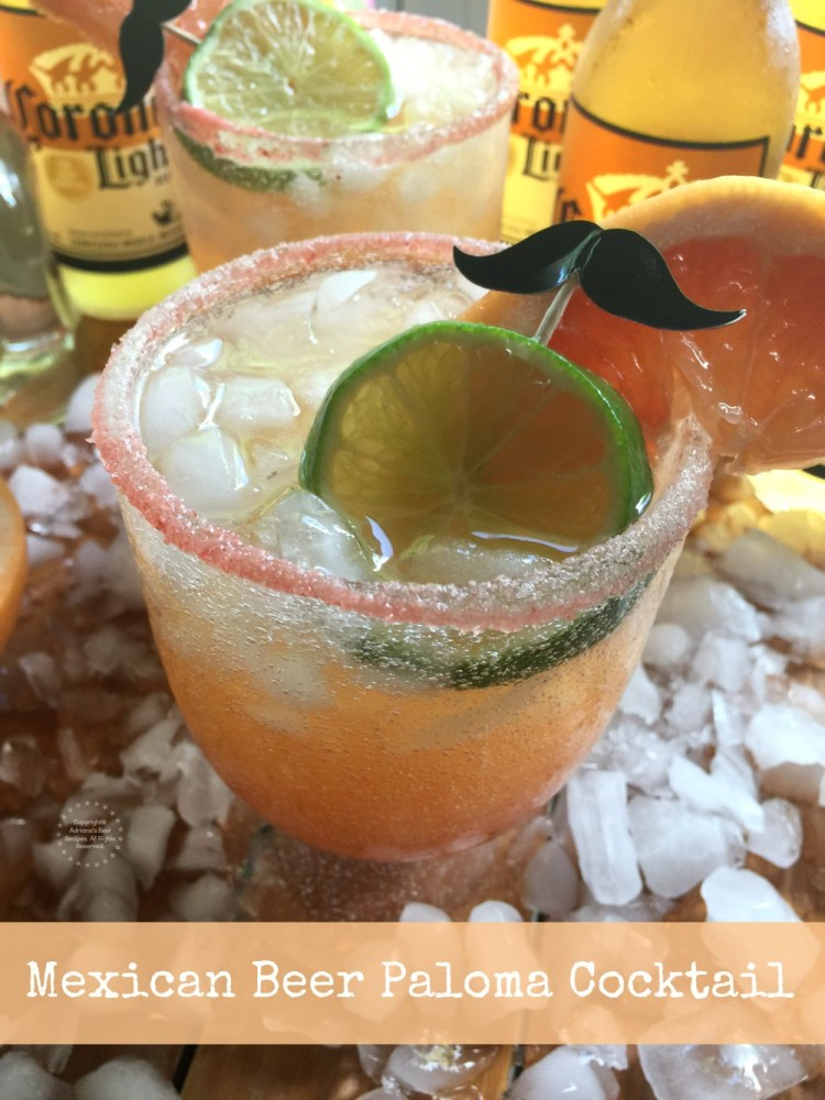This Mexican Beer Paloma Cocktail has grapefruit juice, crushed ice, Casa Noble tequila blanco, pink salt, liquid chamoy, lime, grapefruit slices and Corona Light