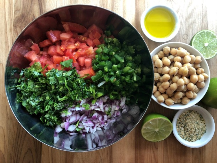 Chop all the produce for making the fresh chickpeas salsa