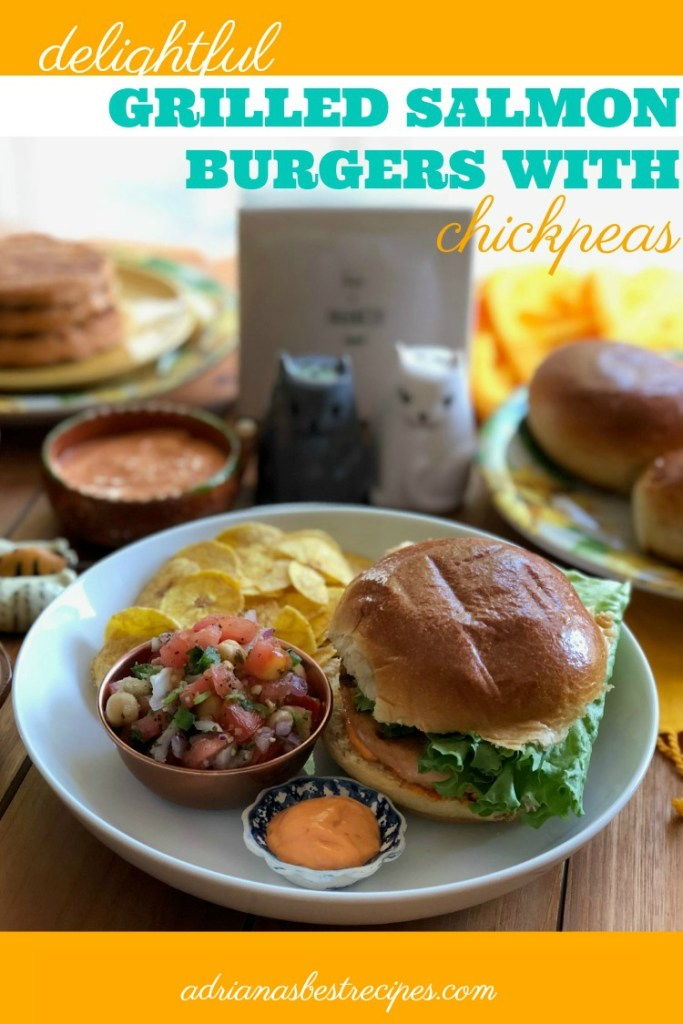 Grilled salmon burgers served on a brioche bun and paired with a fresh chickpeas salsa