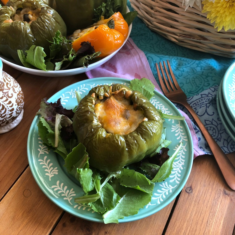 Serving the Mexican Style Stuffed Florida Bell Peppers on a bed of greens for a full meal