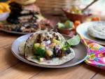 Indulging on exquisite pork tacos al pastor