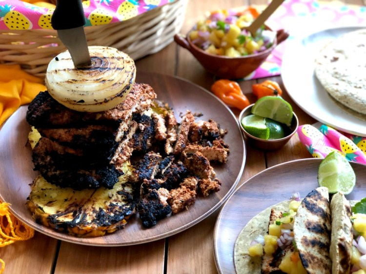 Stack the grilled pork loin steaks for a traditional al pastor experience
