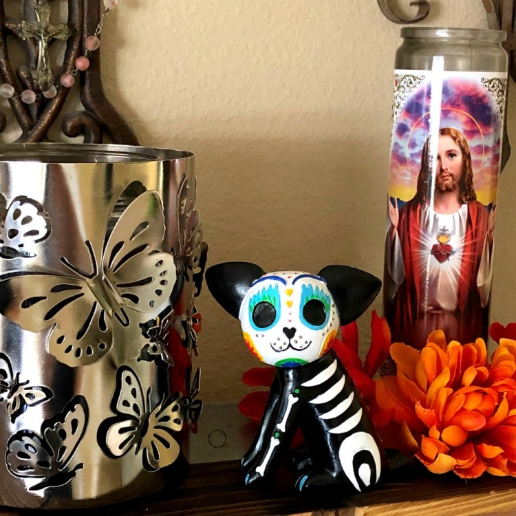 Important symbols such as the Monarch butterfly, the dog and the Sacred Heart