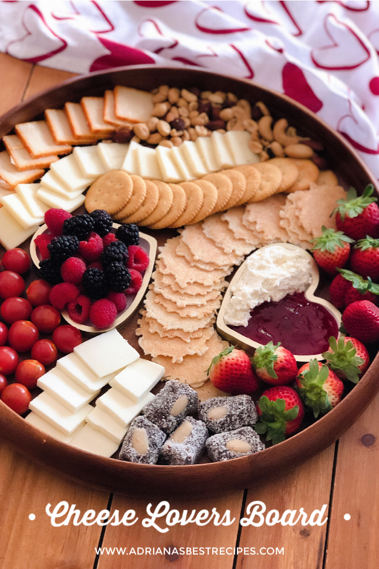 Celebrate cheese lovers day by putting together the best cheese lovers board including a variety of cheeses, fresh produce, fruits, nuts, and crackers. #CheeseLoversDay #cheeseboard