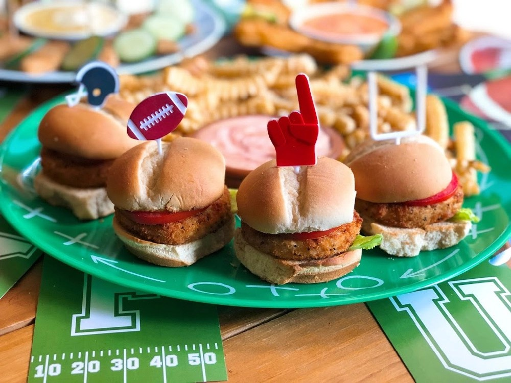 Our vegetarian menu includes Gardein crispy chick'n sliders paired with tomato slices and romaine lettuce with a mayo ketchup sauce and crinkle fries.