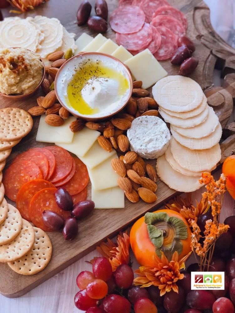 A delightful cheeseboard inspired in Mediterranean cuisine favorites like labneh, hummus, and kalamata olives