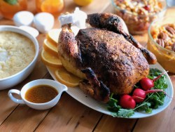 Homemade rotisserie chicken dinner served with all the fixings