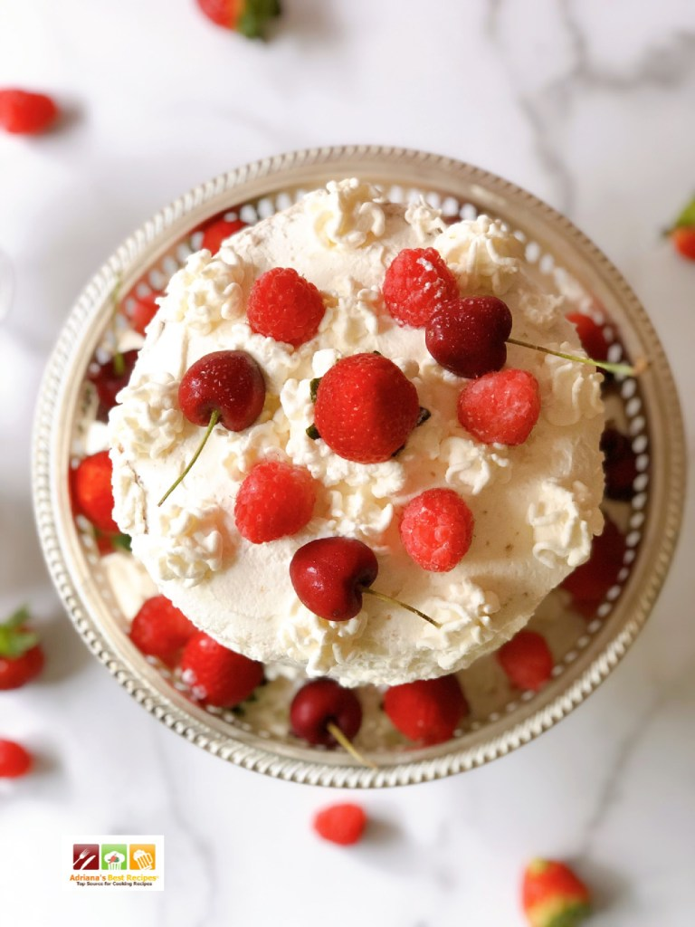A delightful victoria's sponge cake recipe with fresh berries and whipped cream