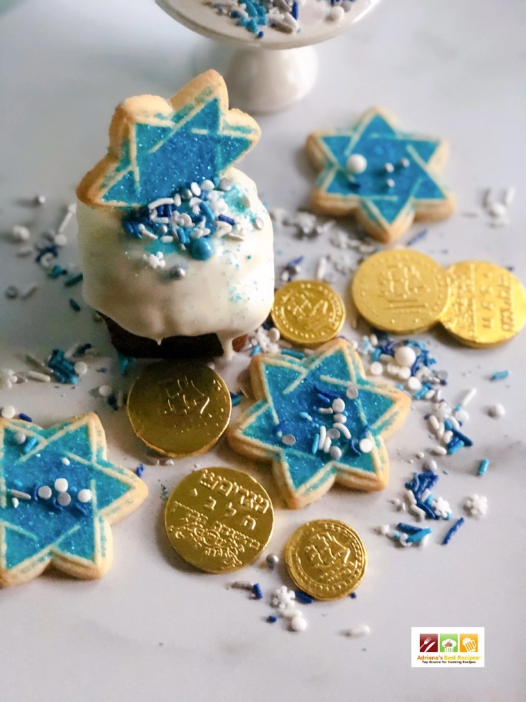 Hanukkah Cupcakes and chocolate coins also called gelt these are tasty holiday treats to eat on this day