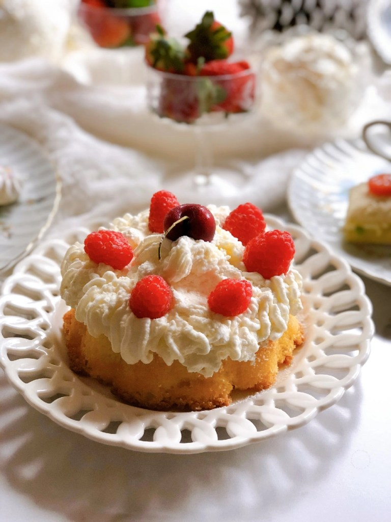 Homemade Victoria Sponge Cake with whipped cream and berries